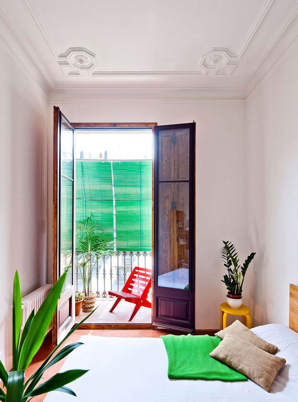 Small balcony connected with the modern bedroom of the Barcelona apartment