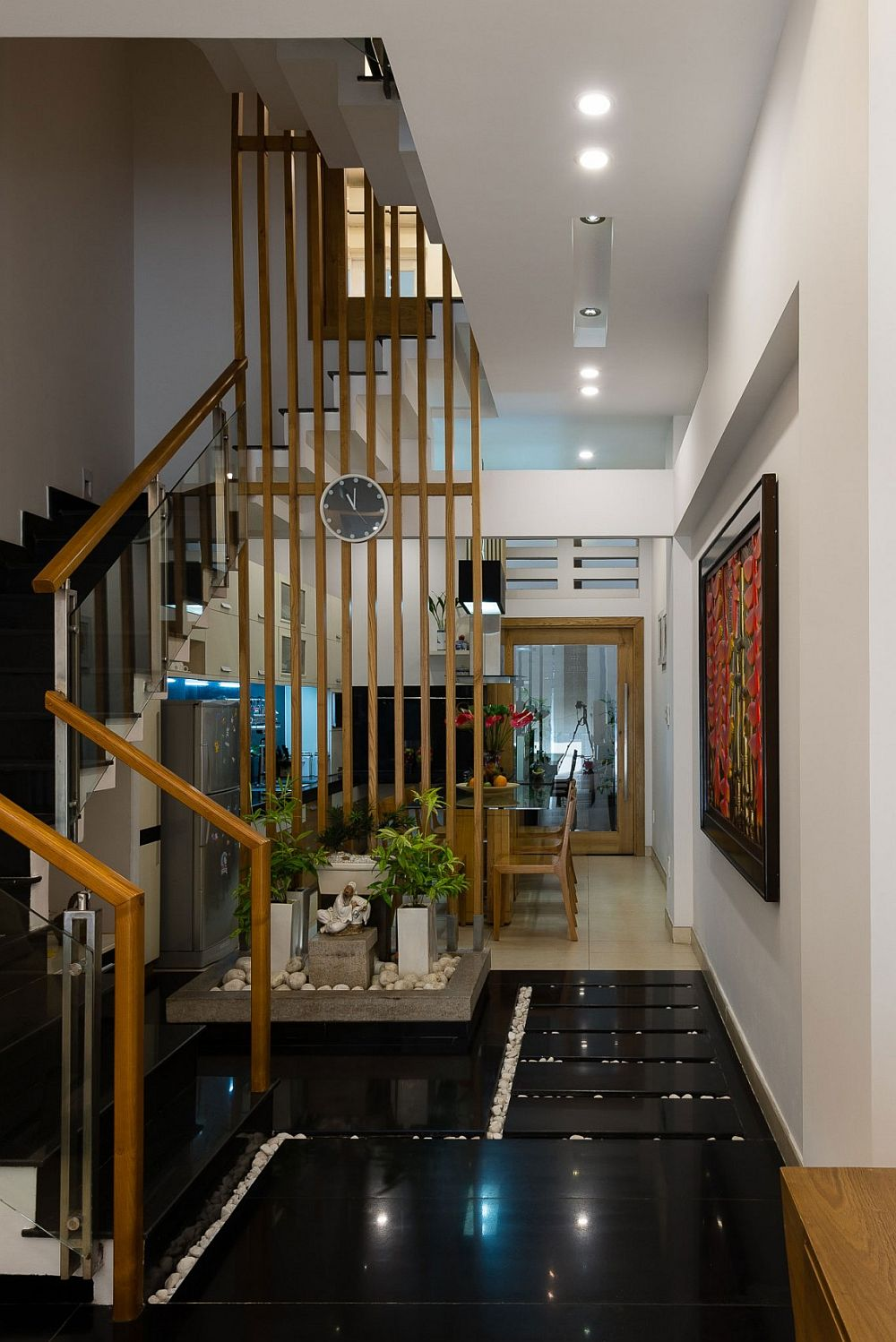 Small indoor garden feature with a light well above creates a refreshing ambiance indoors