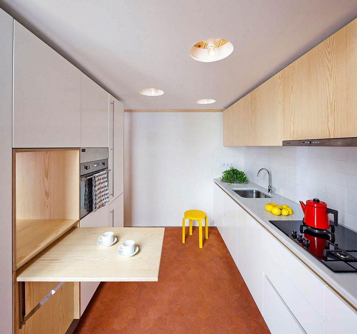 Smart kitchen deisgn for a small apartment acts as a distinct, standalone cabin space