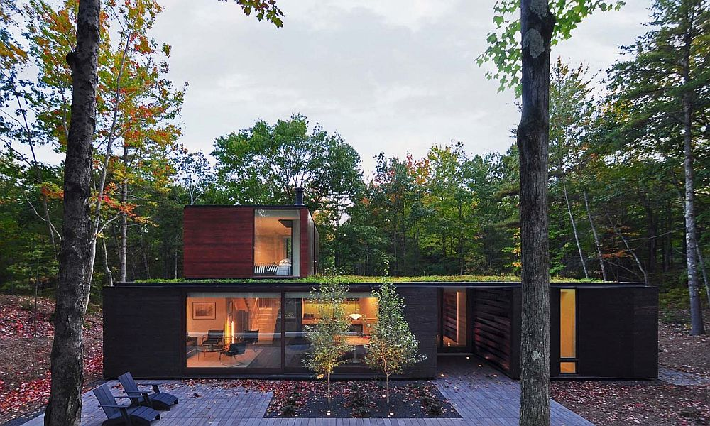 Vegetated roof and charred cedar siding shape the majority of the home's exterior
