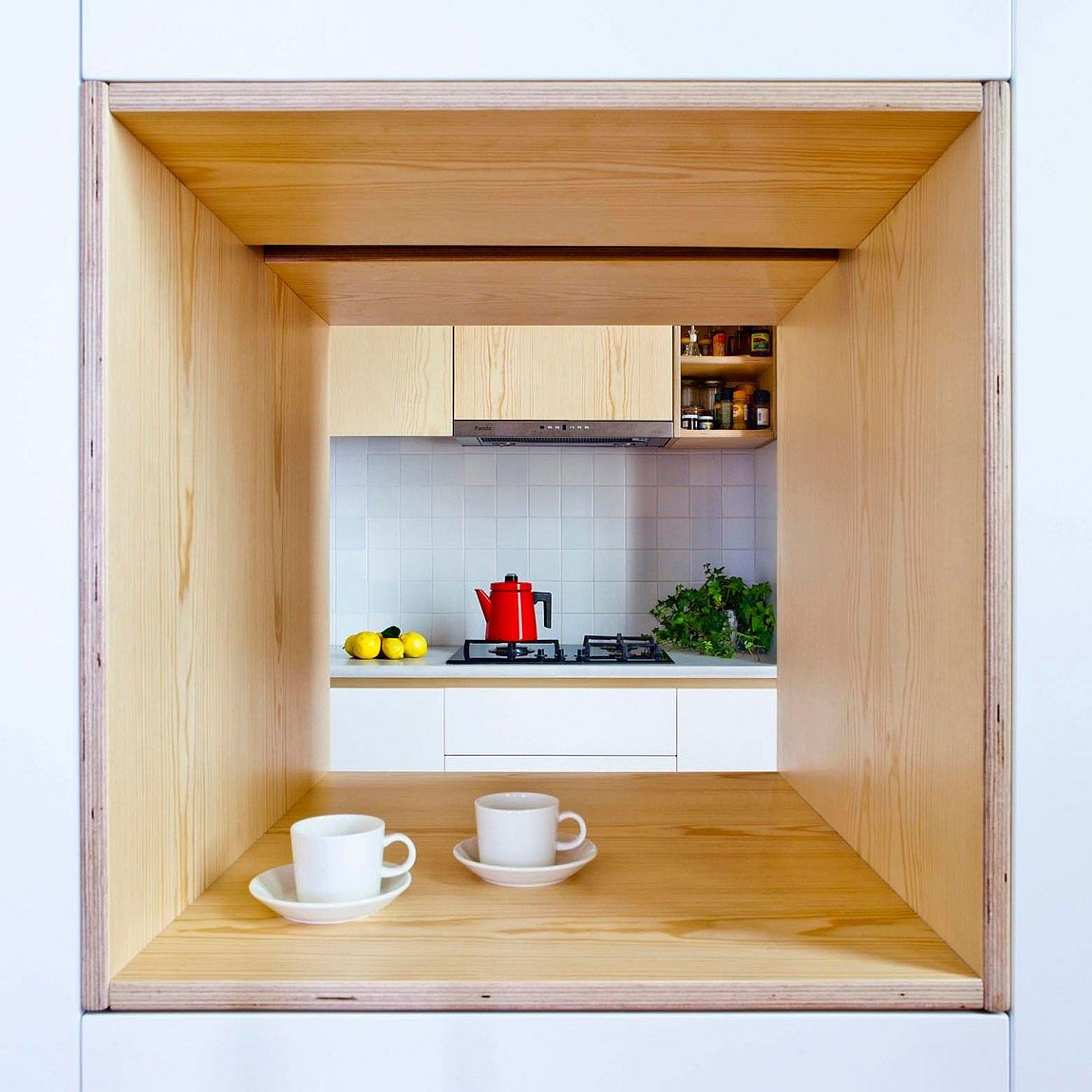 Window into the kitchen also serves as a cool serving station