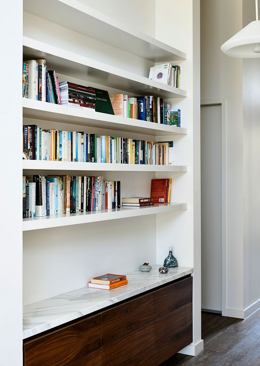 Book collection adds color to the neutral interior