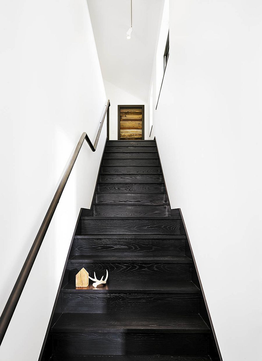 Dark staircase gives the stairway visual contrast