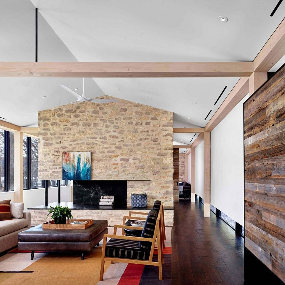 Gorgeous living room of Prefab Austin Home with stone accent wall and wooden walls