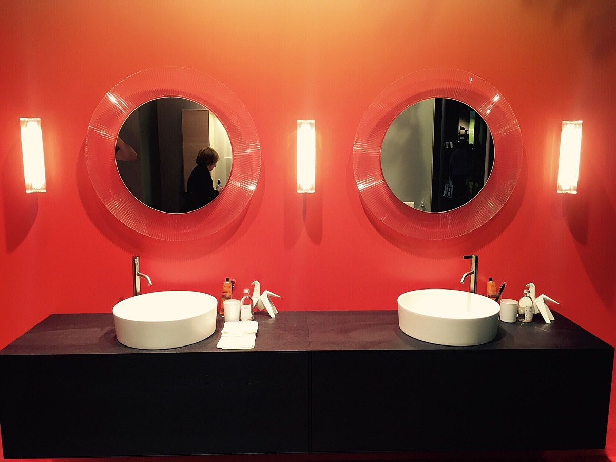 Oraneg and black is a color scheme you can try out as well in the bathroom