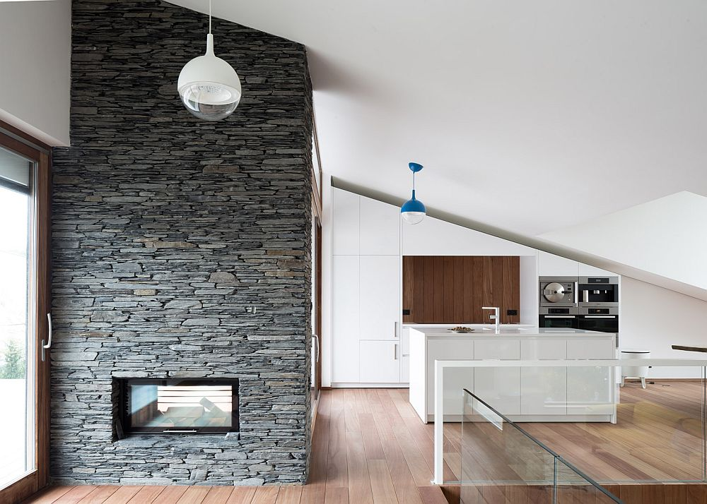 Stone wall with fireplace and kitchen of the beautiful Belgian house