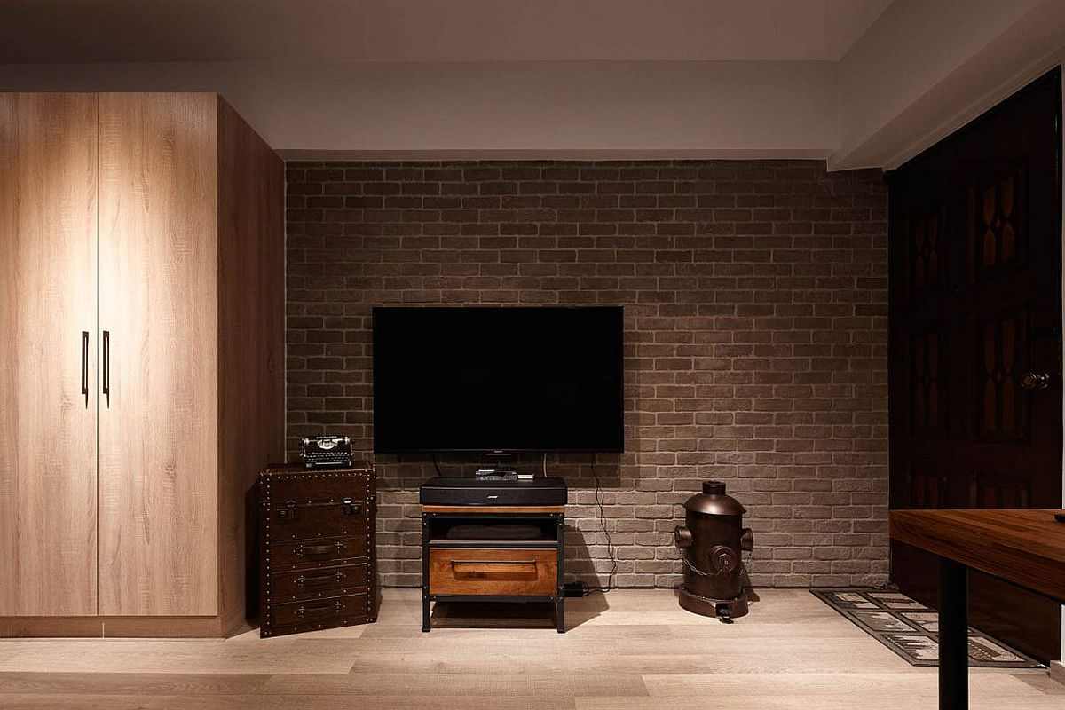 Brick accent wall section delineates the TV zone form the rest of the interior