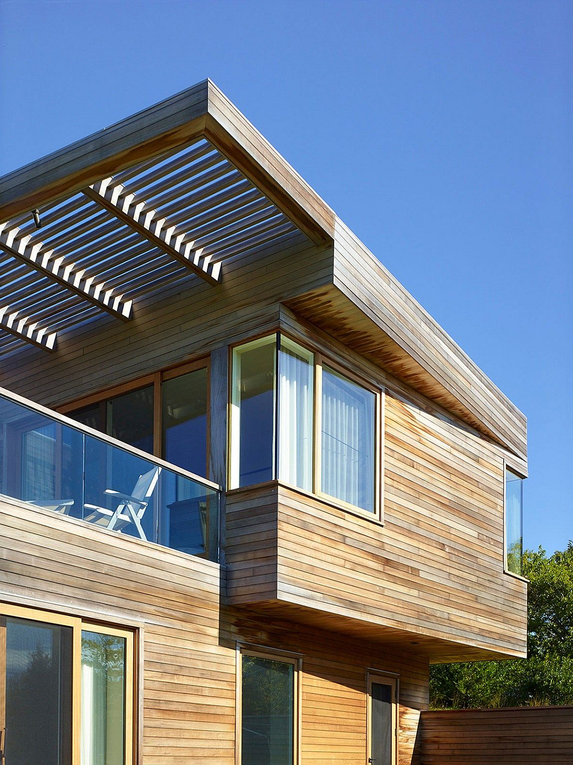 Cedar shiplap adds textural beauty to the exterior of the house