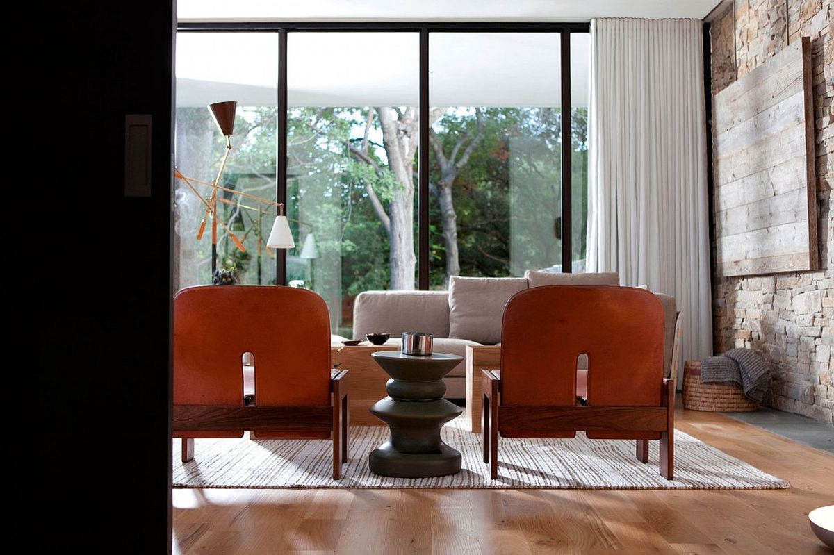 Combination of drapes and glass doors offer smart ventilation and privacy