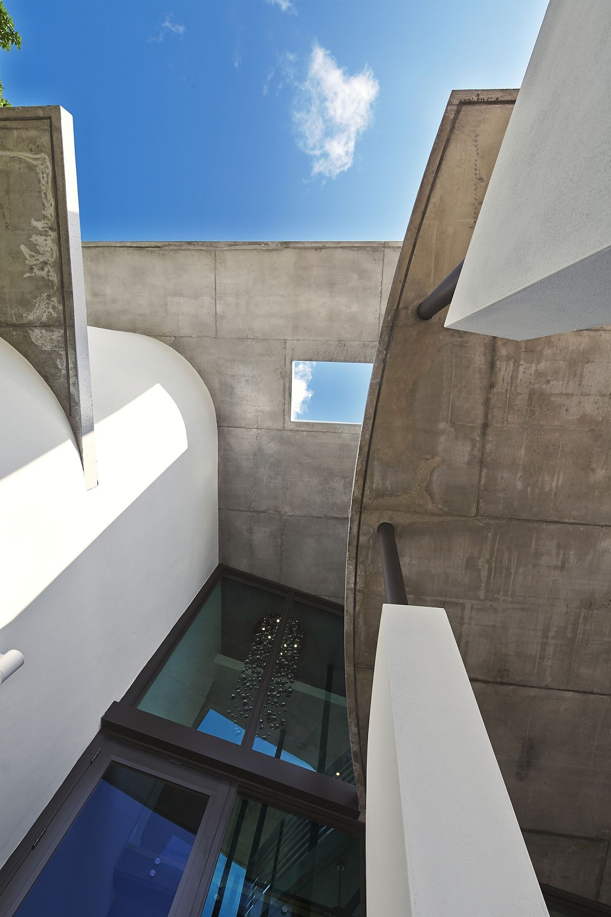 Concrete roof lines offer visual and textural contrast a the smart home