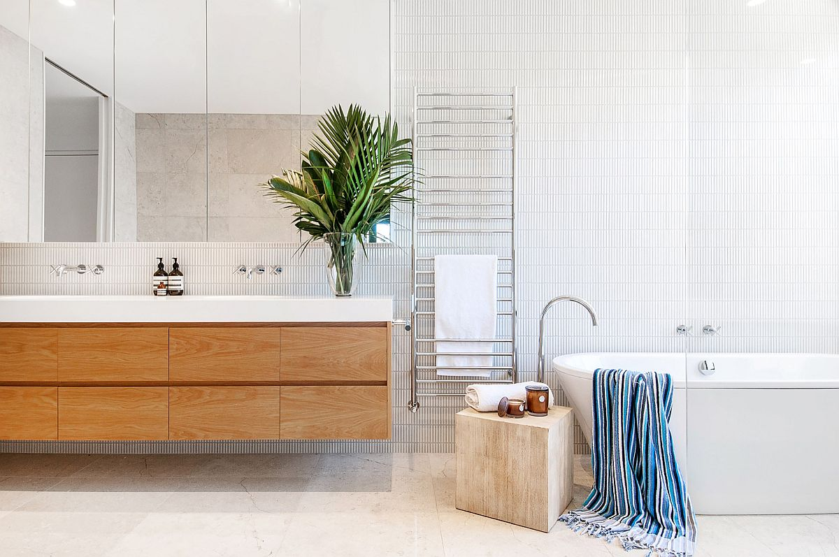 Contemporary bathroom in white with wooden floating vanity and a small stool next to the bathtub