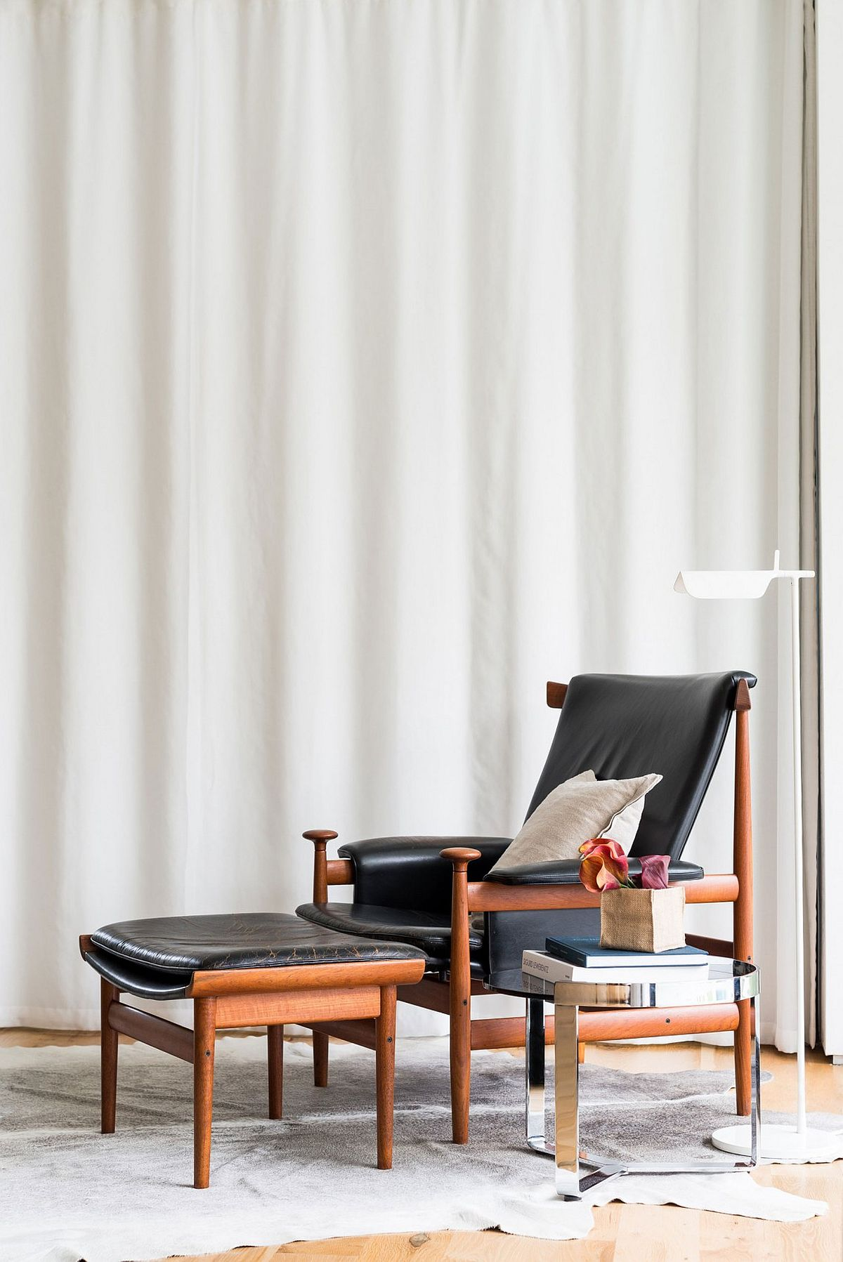 Craft a classy reading nook with confortable lounger and a simple side table