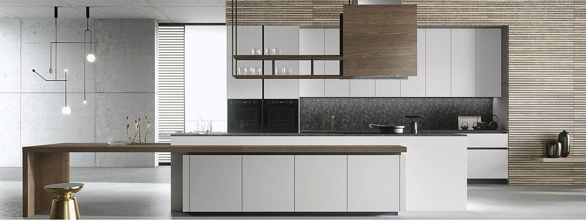Handleless panel doors give the kitchen a minimal and sleek look