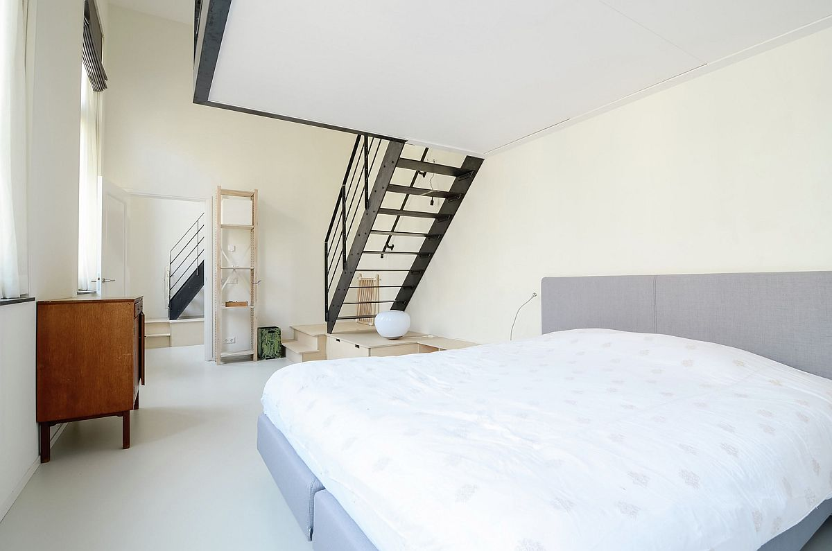 Master bedroom with ample light and mezzanine level