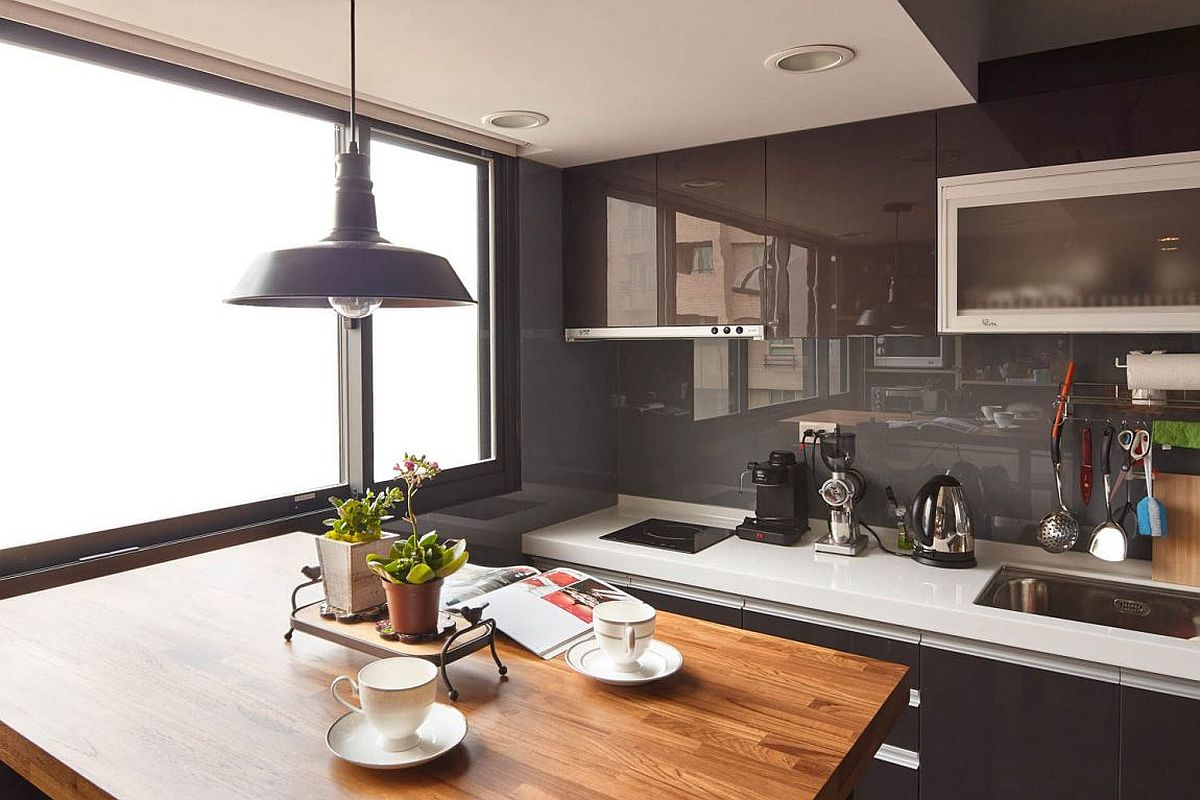 Small kitchen in the corner of industrial modern Taipei City apartment with a tiny dining station
