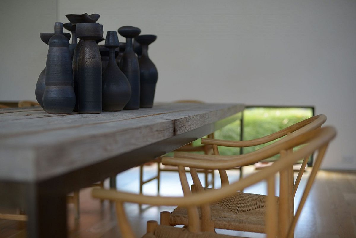 Table surface and chairs add a hint of rustic charm to the modern interior