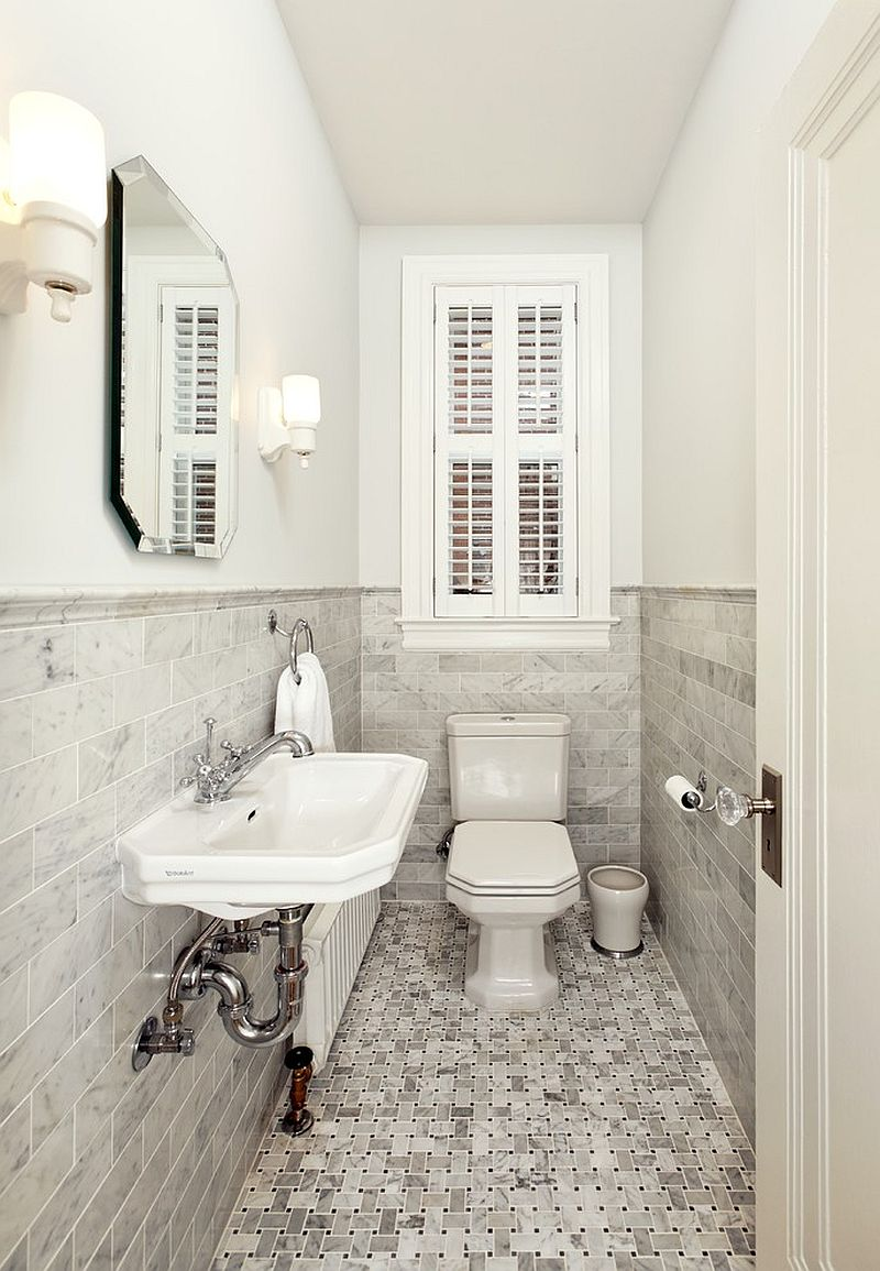 Ultra narrow powder room relies on a monochromatic look for a spacious visual appeal