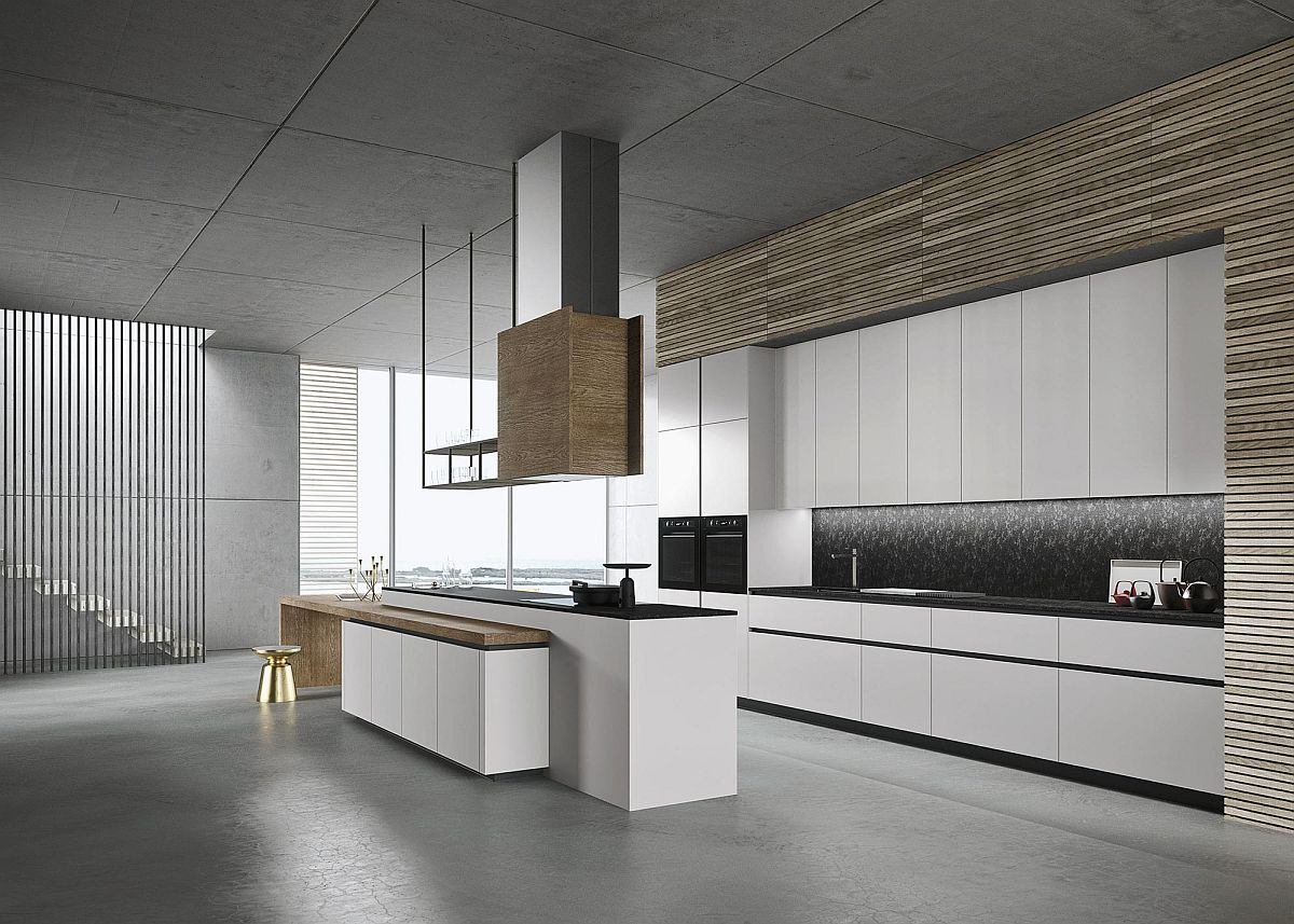 Wooden finishes in the kitchen give it a touch of warmth despite the minimal style