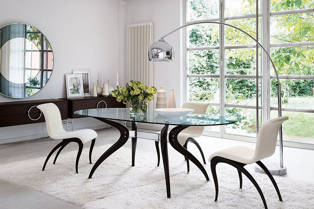 Beautiful dining table with distinct metal and wood base and glass top