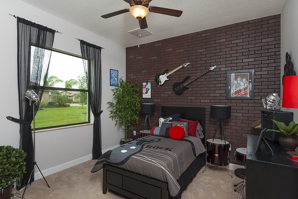 Cool teen bedroom with accent brick wall and guitar on the walls [Design: Stanley Homes]