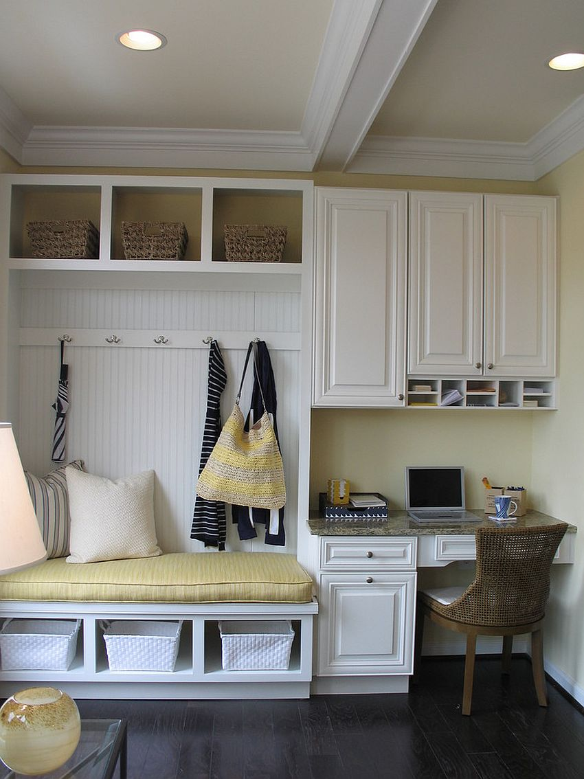 Making use of the small corner space in the tiny mudroom with smart seating [Design: Carlyn And Company Interiors + Design]