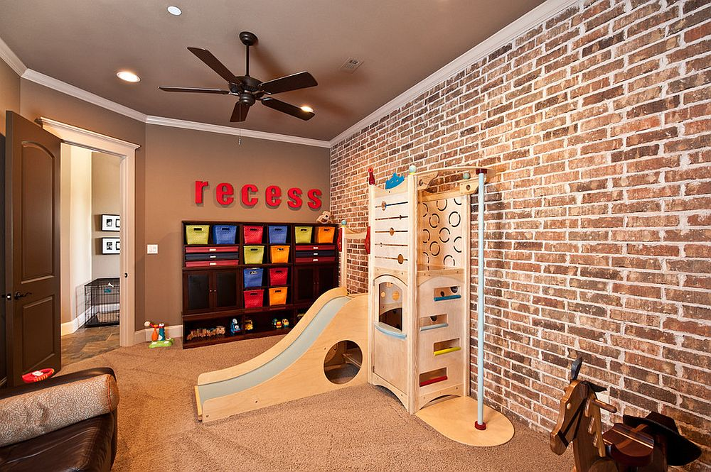 Organized playroom with brick wall and slide [Design: Drew Walling Custom Homes]