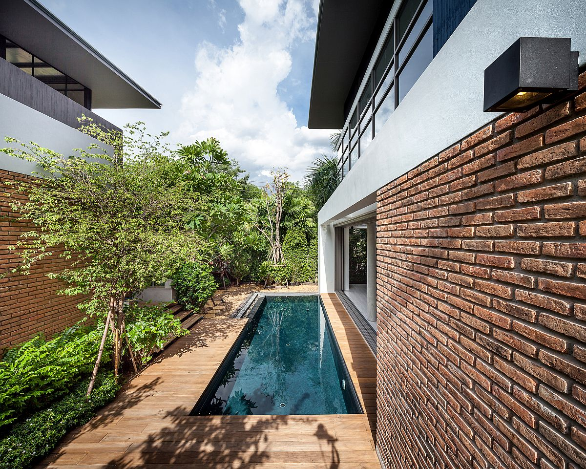 Patio and pool area connect the two houses in Bangkok, Thailand