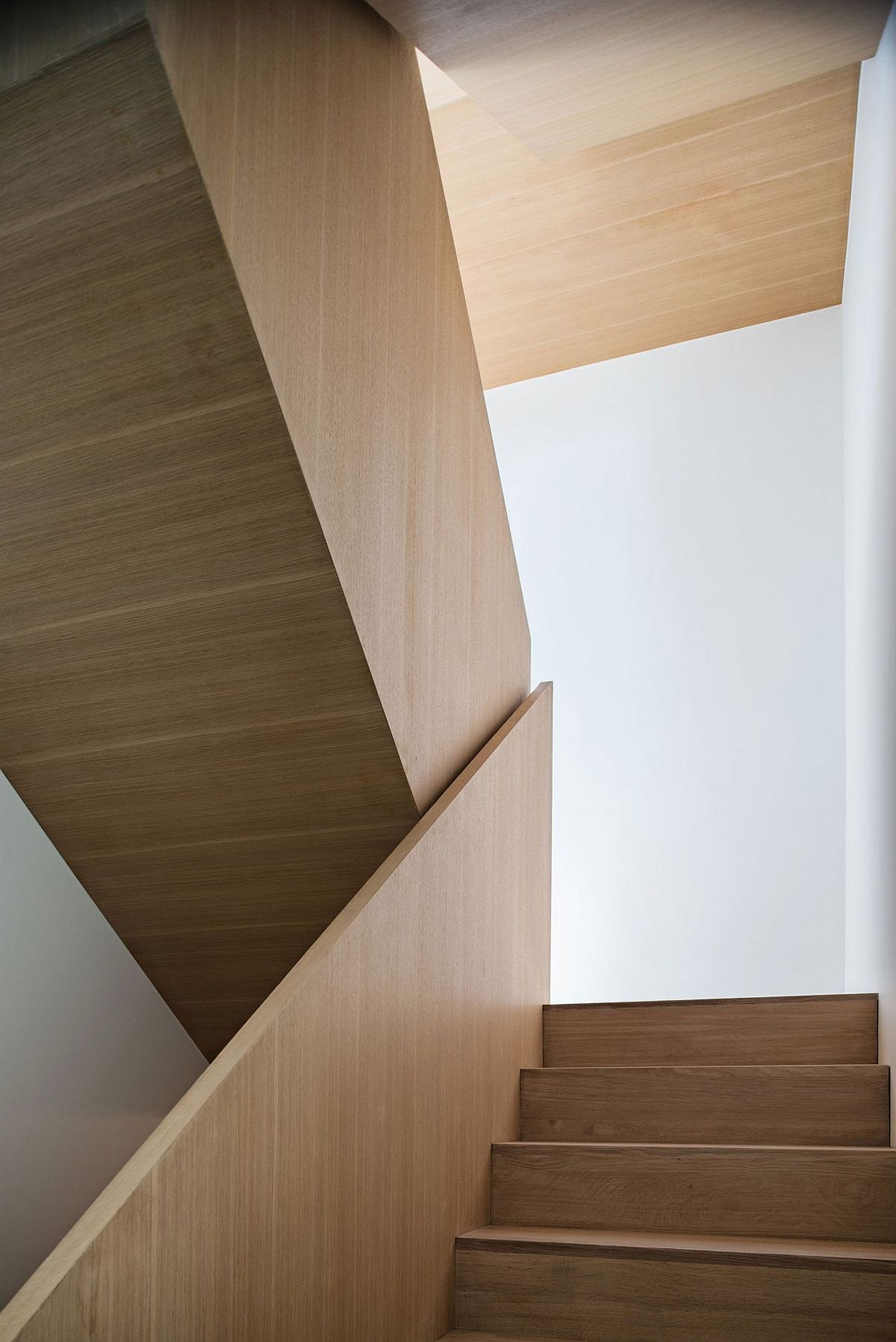 Sculptural wooden staircase inside the modern Toronto house
