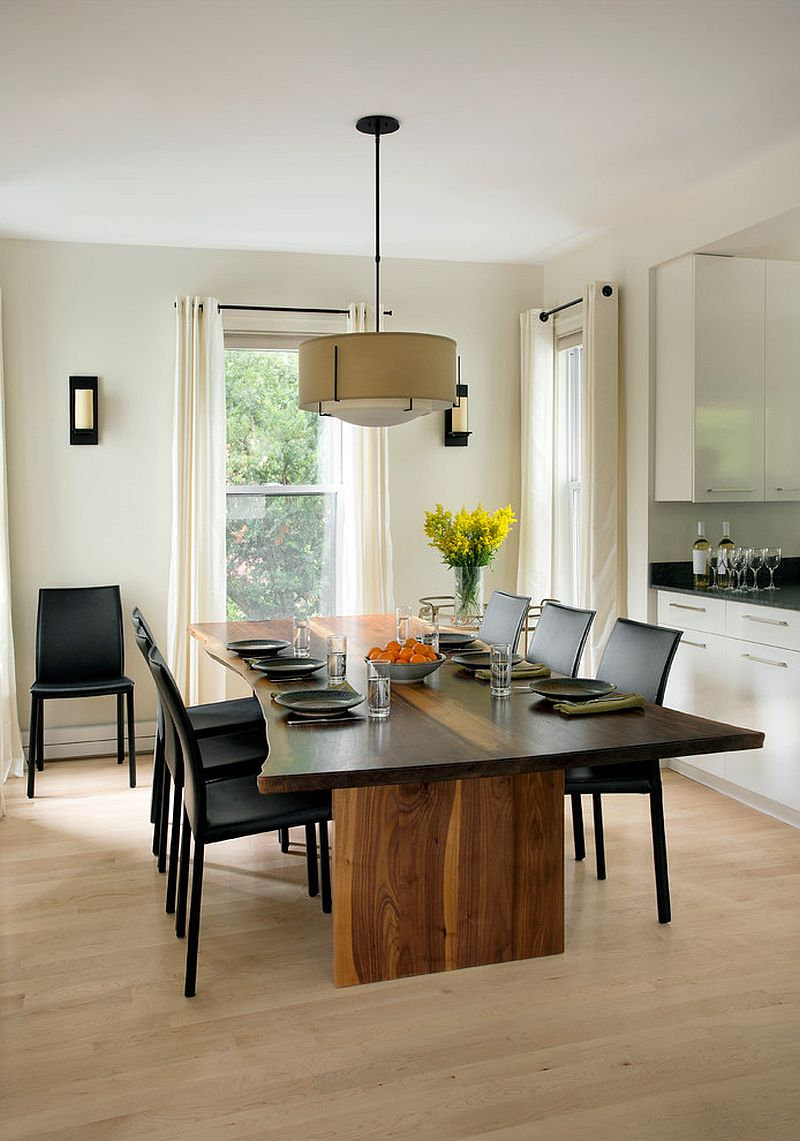 A glossy finish gives the dining table a more modern sheen [From: Morse Constructions / Elza B. Design / Eric Roth Photography]