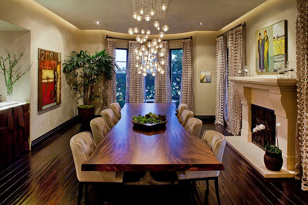 Cascading chandelier coupled with live edge table in the dining room [Design: Gordon Gibson Construction]