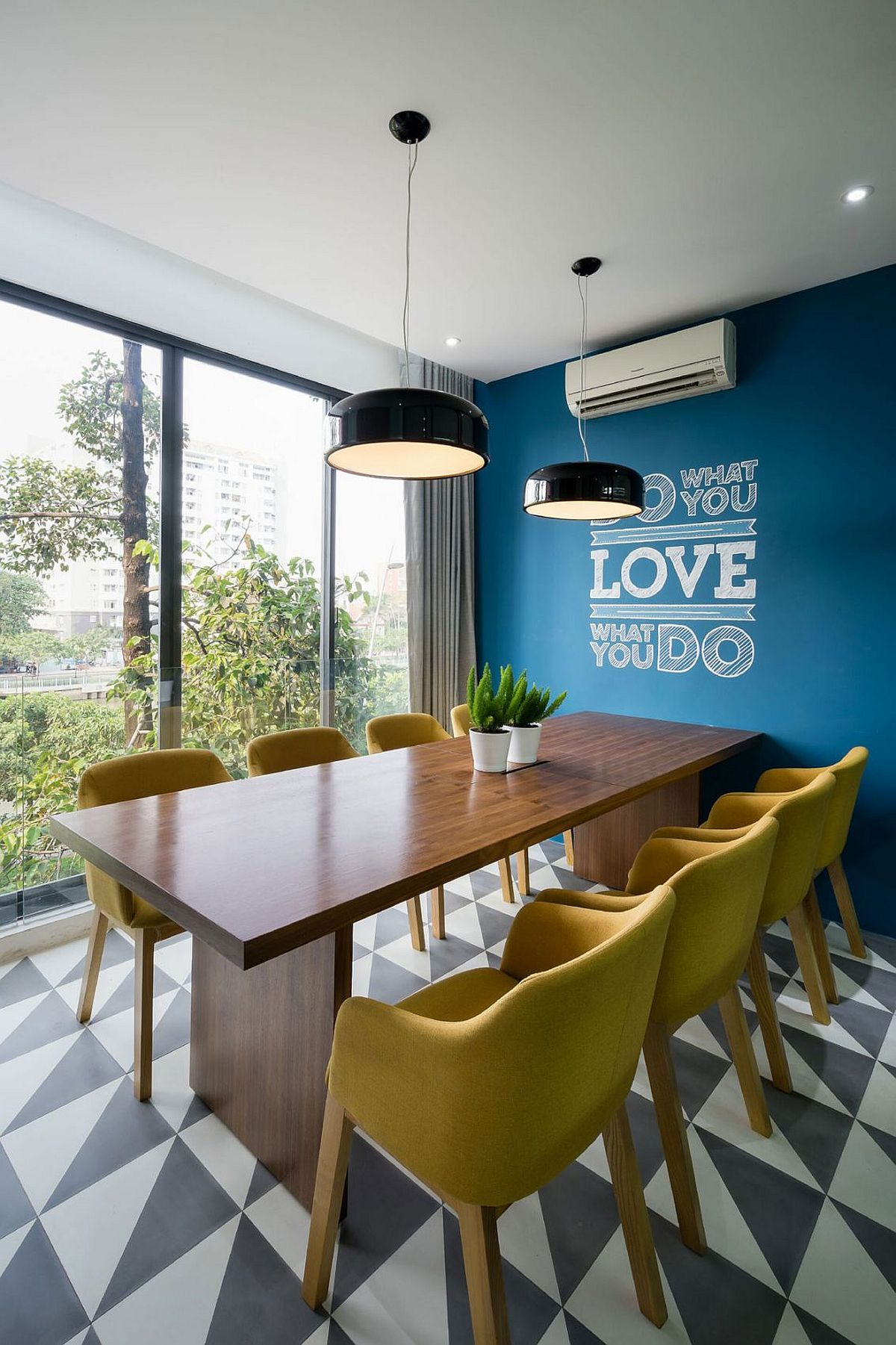 Conference area and workstation with a splash of blue and geo tiled flooring