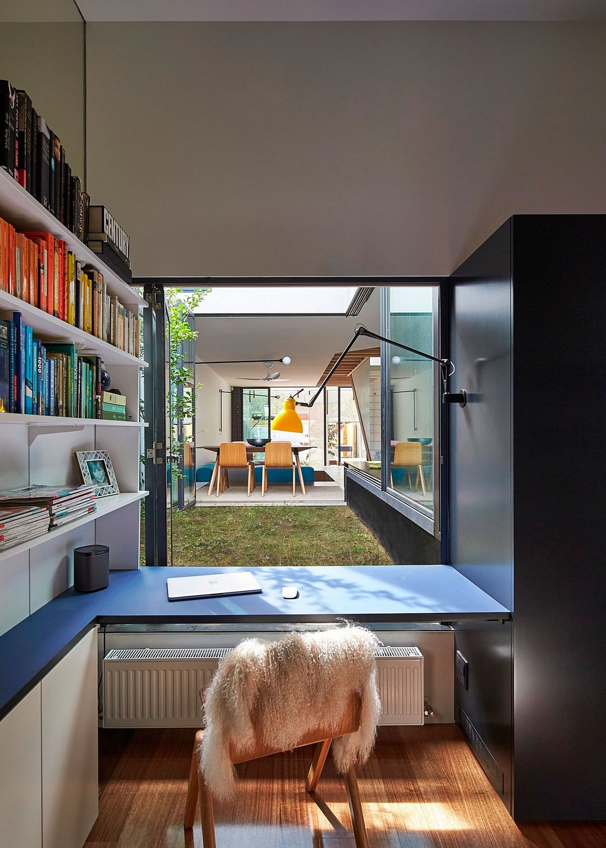 Home workspace connected with the small yard outside