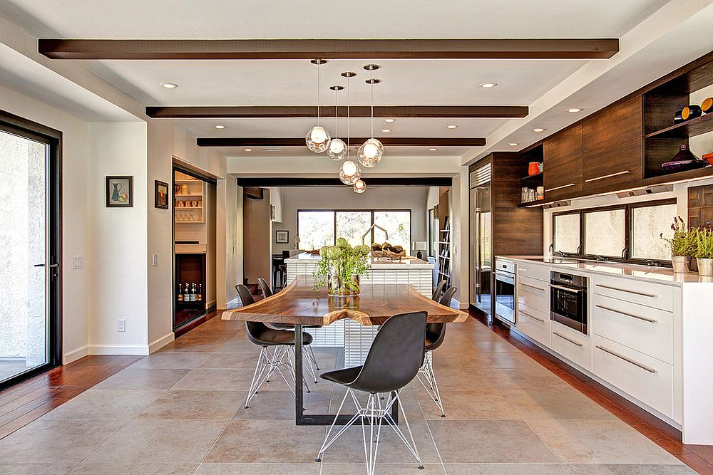 Iconic Eames Molded Plastic Chairs coupled with live edge table in the dining room [Design: Jackson Design and Remodeling]
