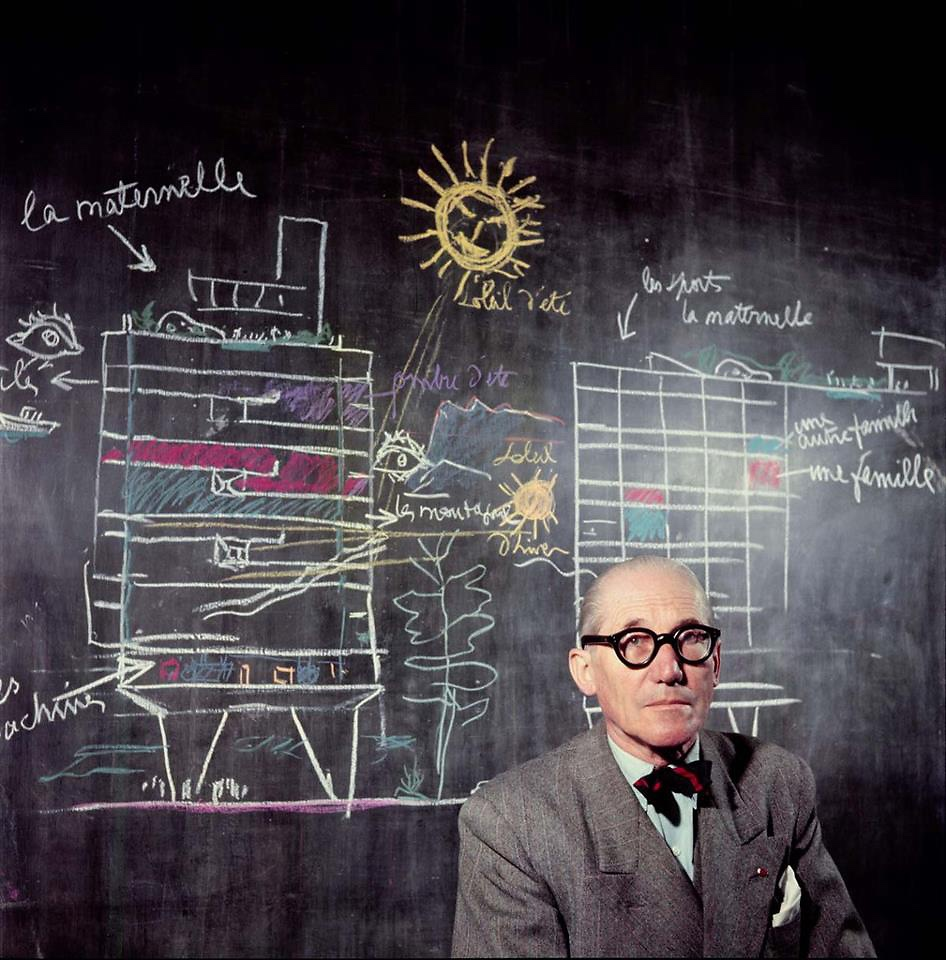 Le Corbusier in front of a section drawing of hisUnité d'Habitation. Photographed in1953 byWilly Rizzo. Image via Fast Company.