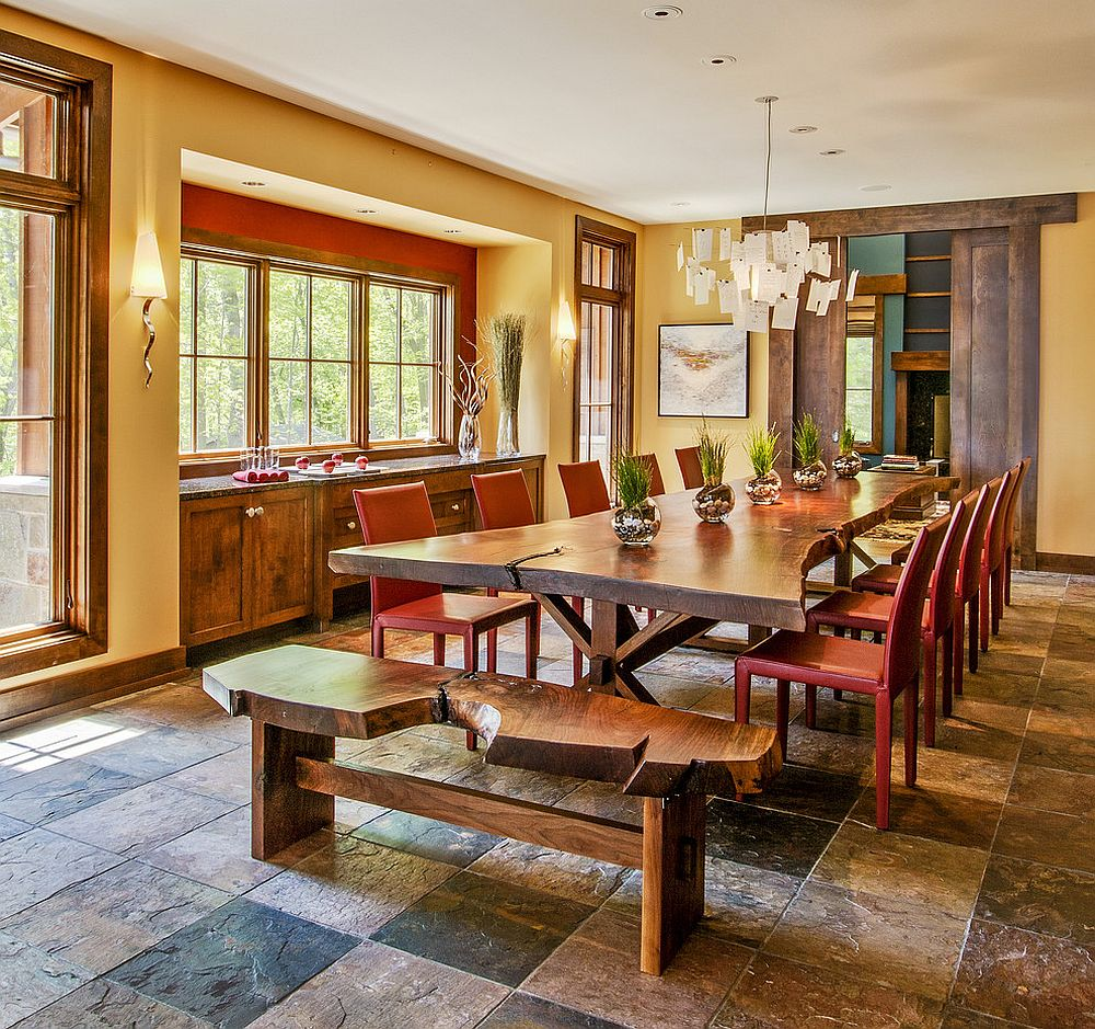 Live edge bench and dining table paired with colorful red chairs [Design: Deep River Partners]