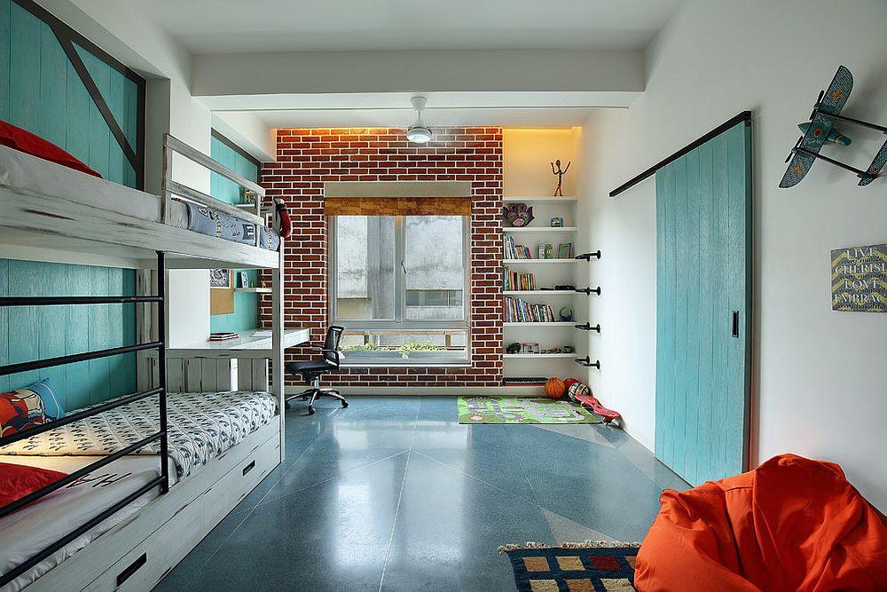 Modern kids' bedroom celebrates the beauty of the barn door
