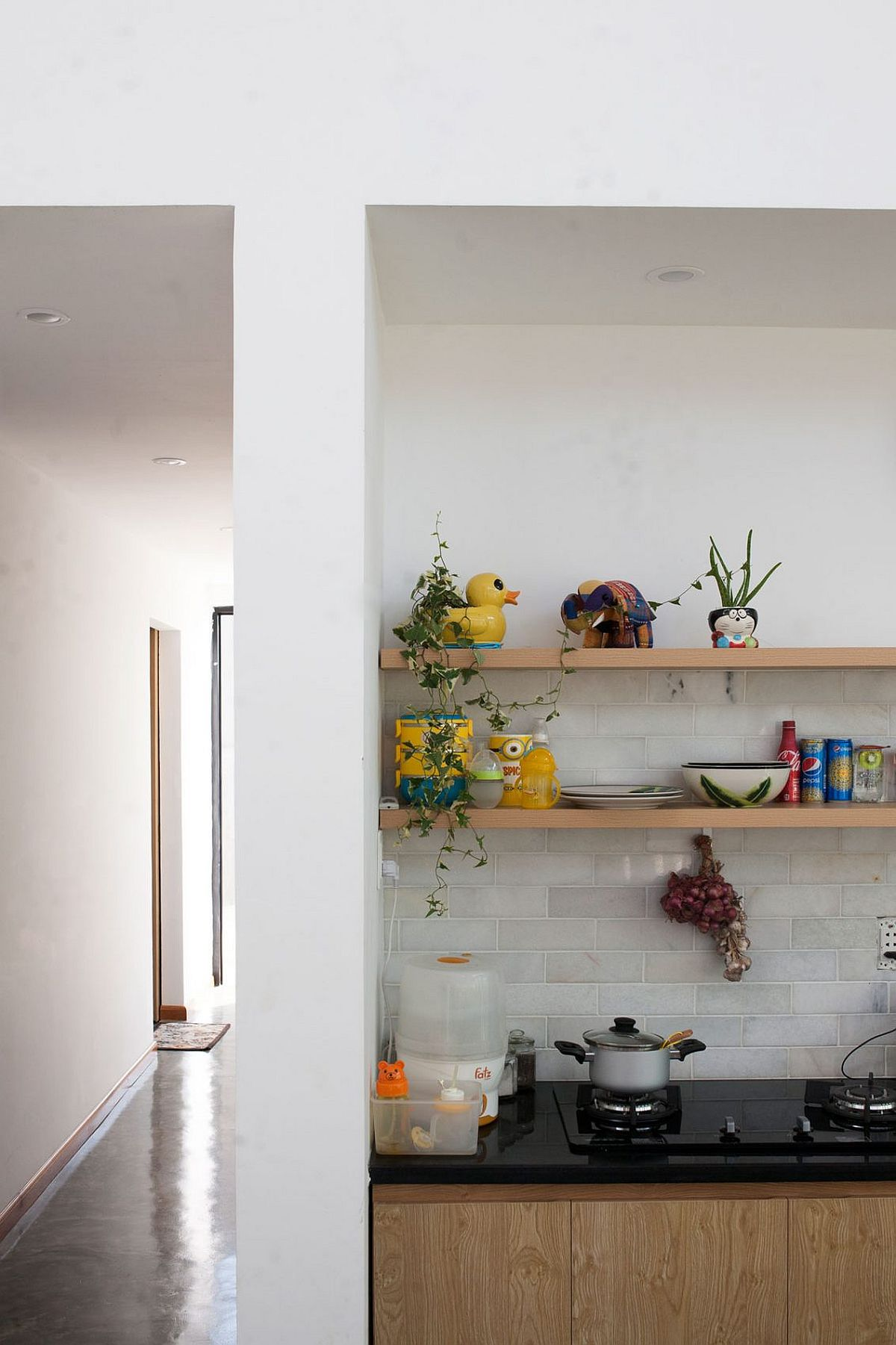 Open shelves above the kitchen counter at the stylish modern house in Vietnam