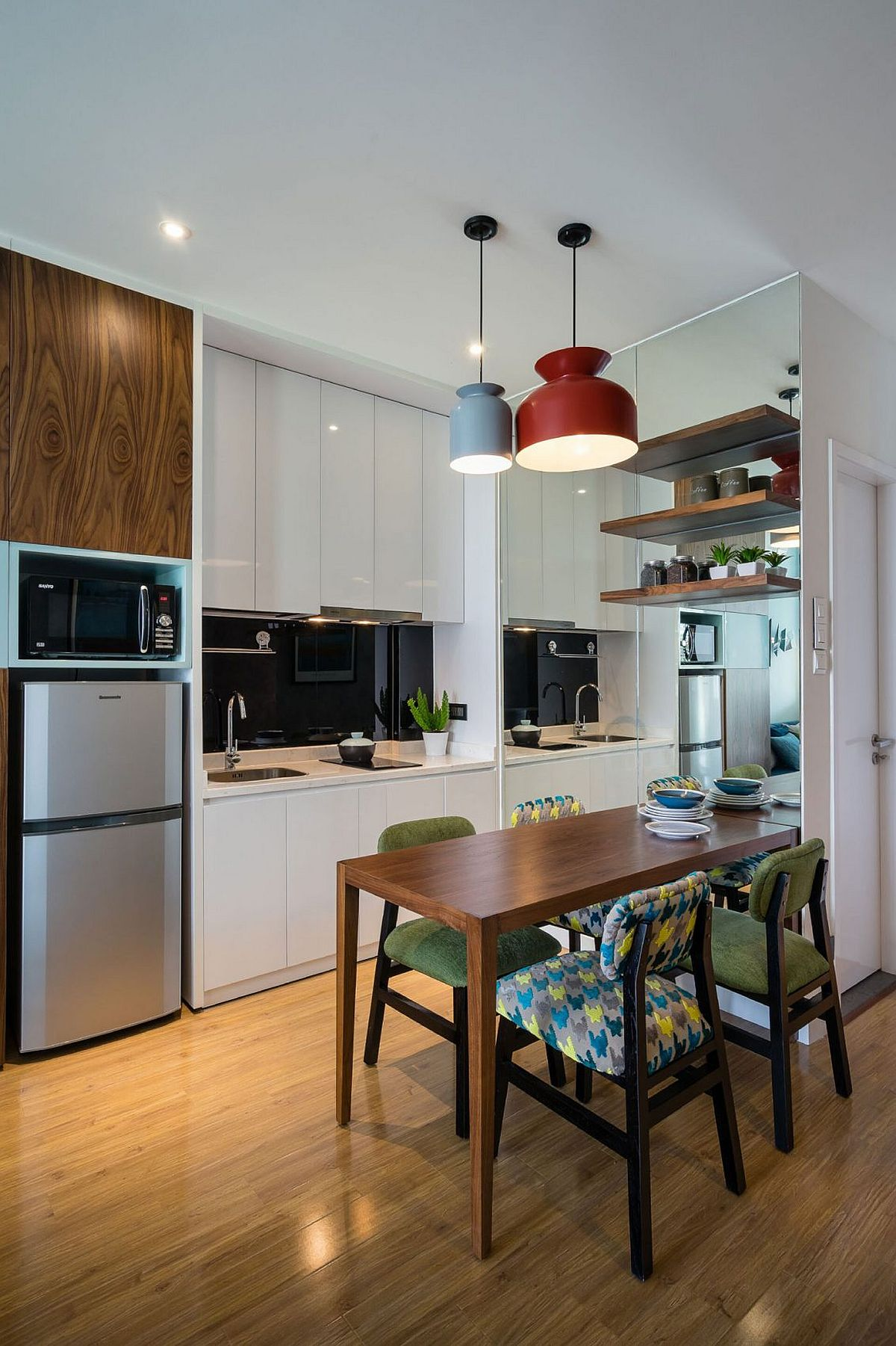 Pendant lights and metallic finishes give the kitchen and dining an airy ambiance