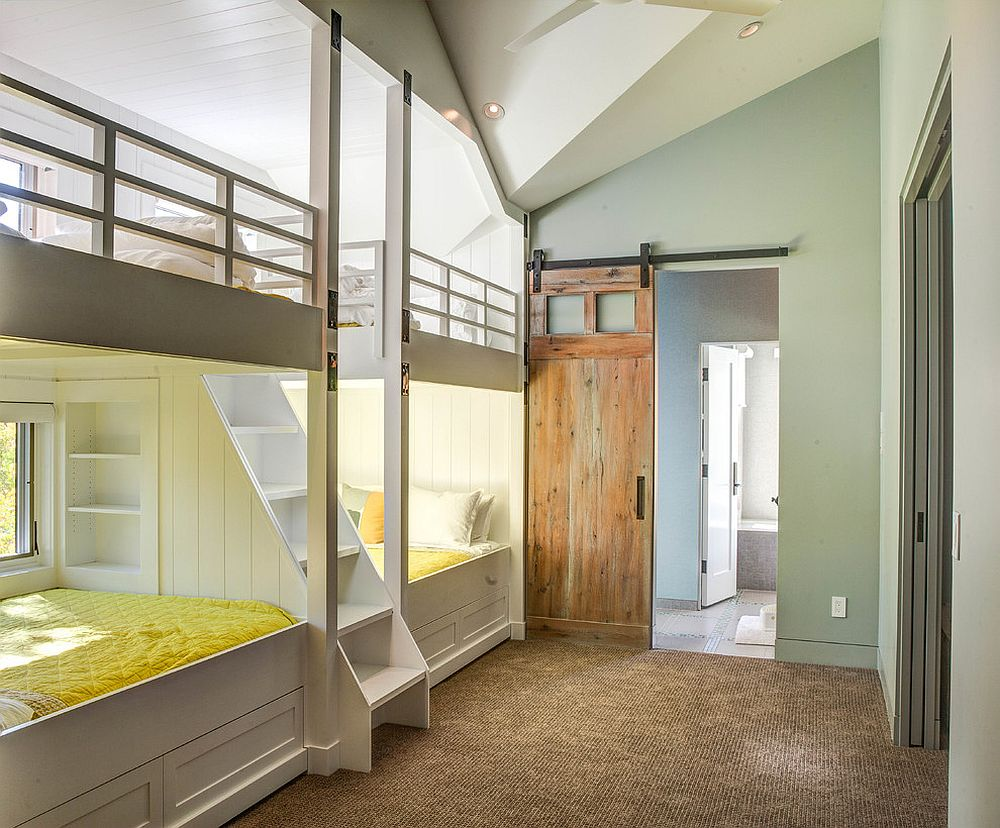 Sliding barn door in the kids' room with wall of bunk beds is a space-saver