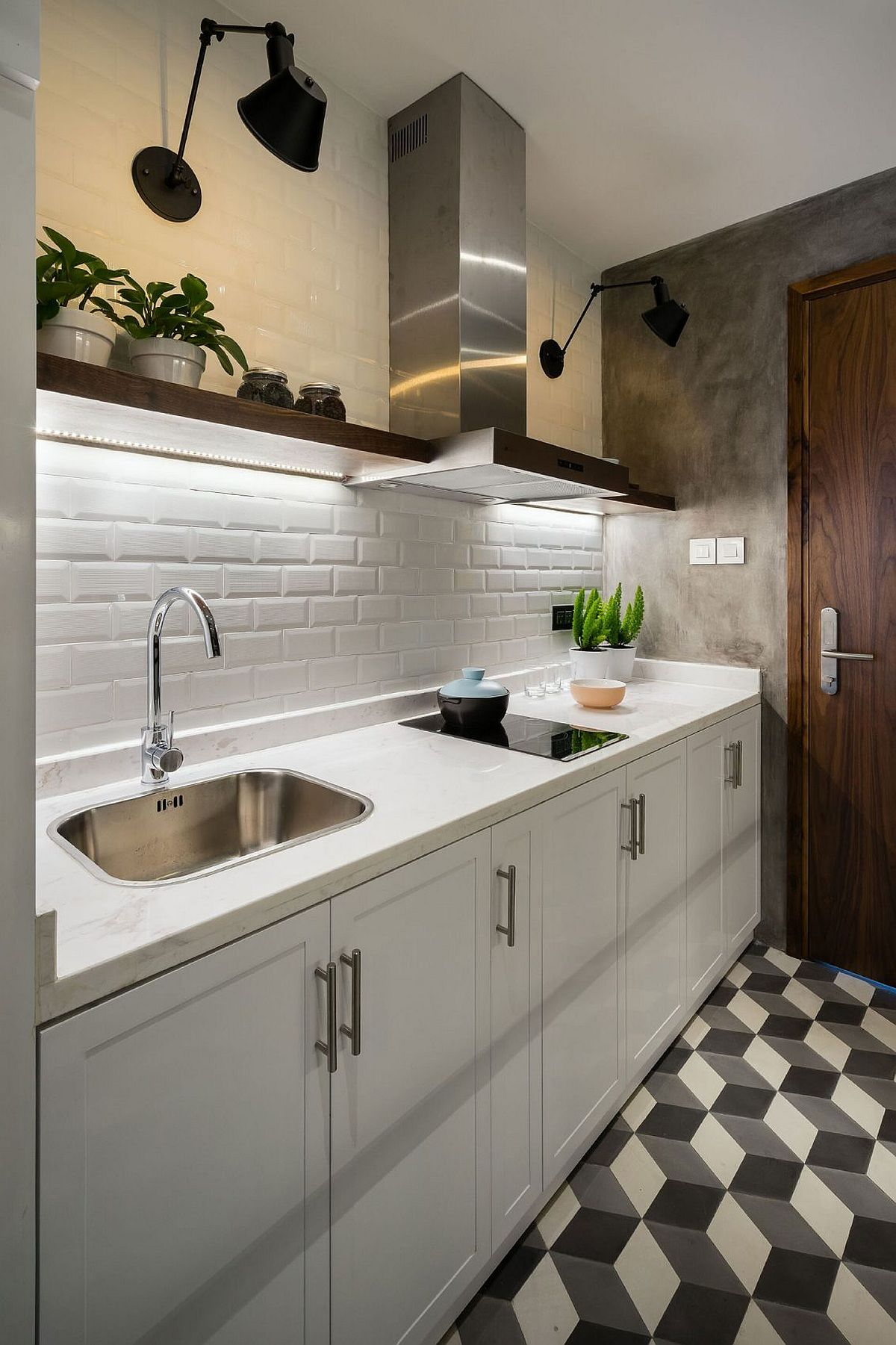 Small kitchen with white tiles and under cabinet lighting