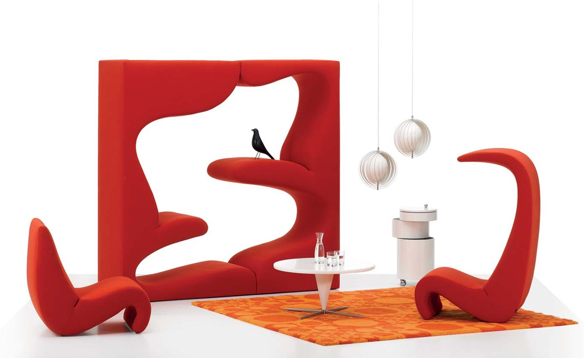Amoebe chair and high-back version (pictured with Verner Panton's 1969 Living Tower). Image via Hive.