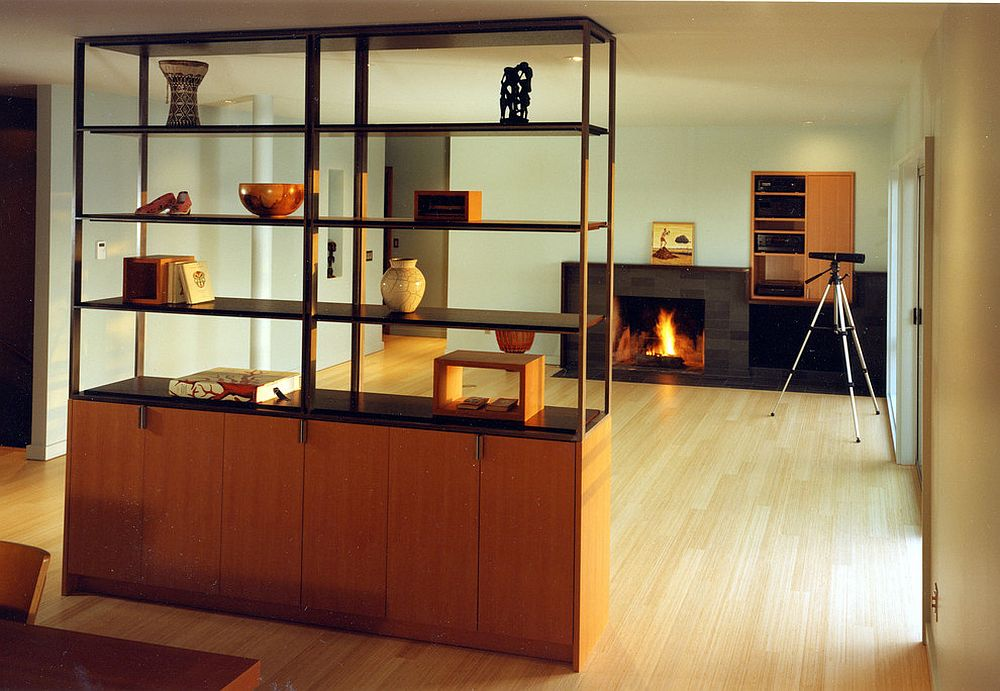 Cupboard and bookshelf unit offers storage and display space even while doubling as a room divider