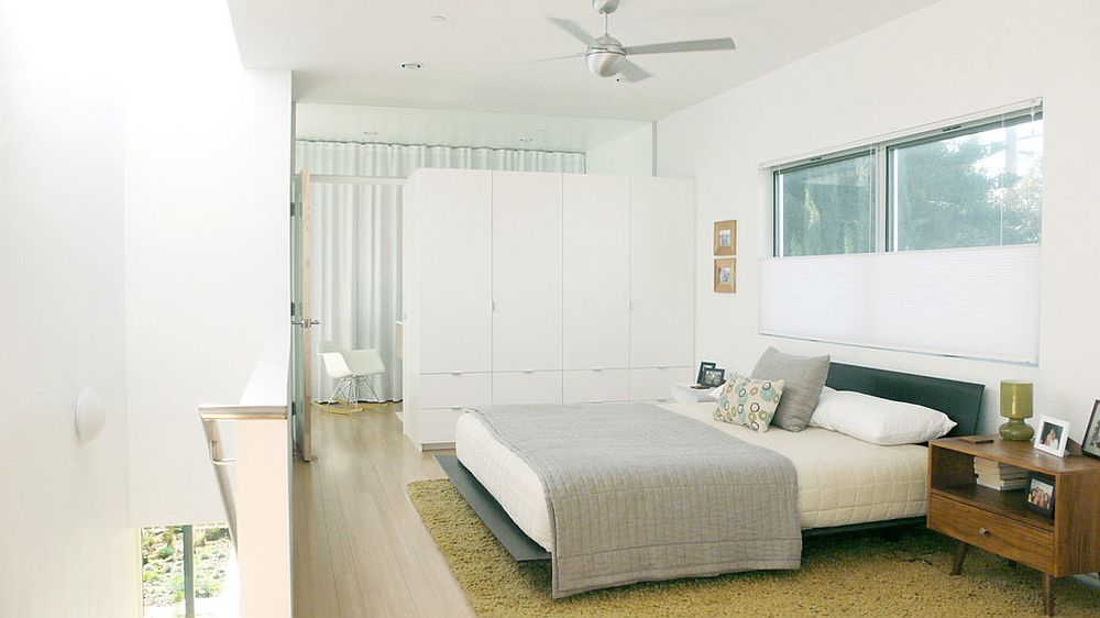 Custom built room divider also offers ample wardrobe space