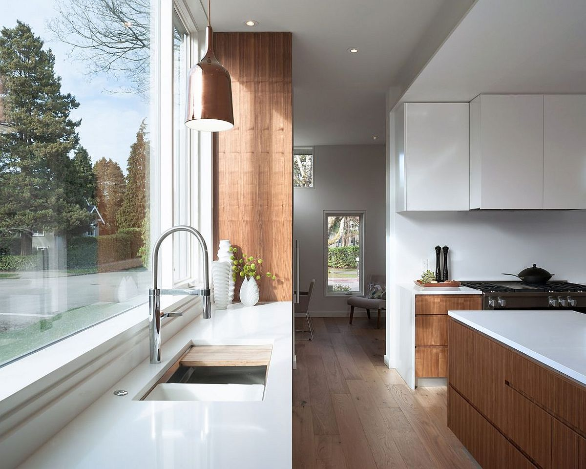 Pendant lighting coupled with natural light for the kitchen counter