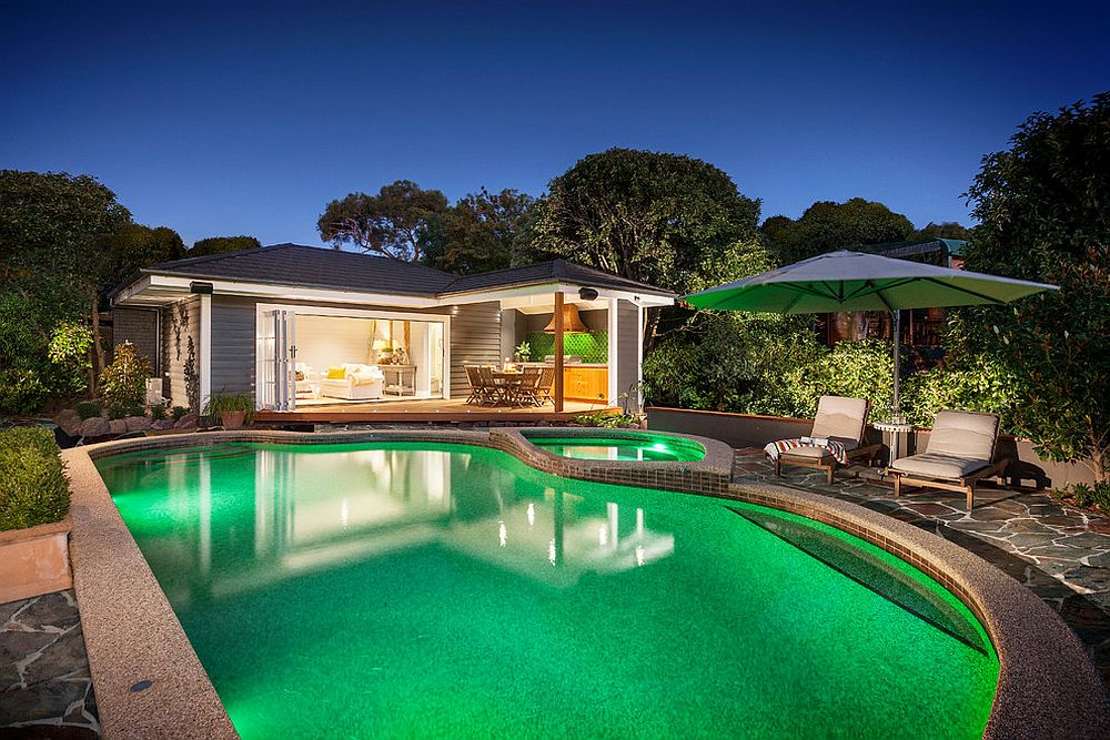 Fabulous pool house with al fresco dining and comfy seating for guests [Design: Acorn Garden Houses]