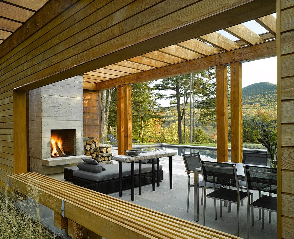 Fireplace and smart seating inside the contemporary pool house [Design: Wagner Hodgson]