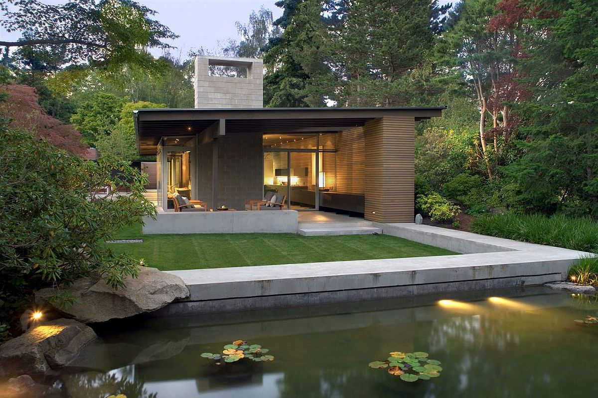 Gorgeous ponds surround the stylish modern cabin-styled home in Seattle
