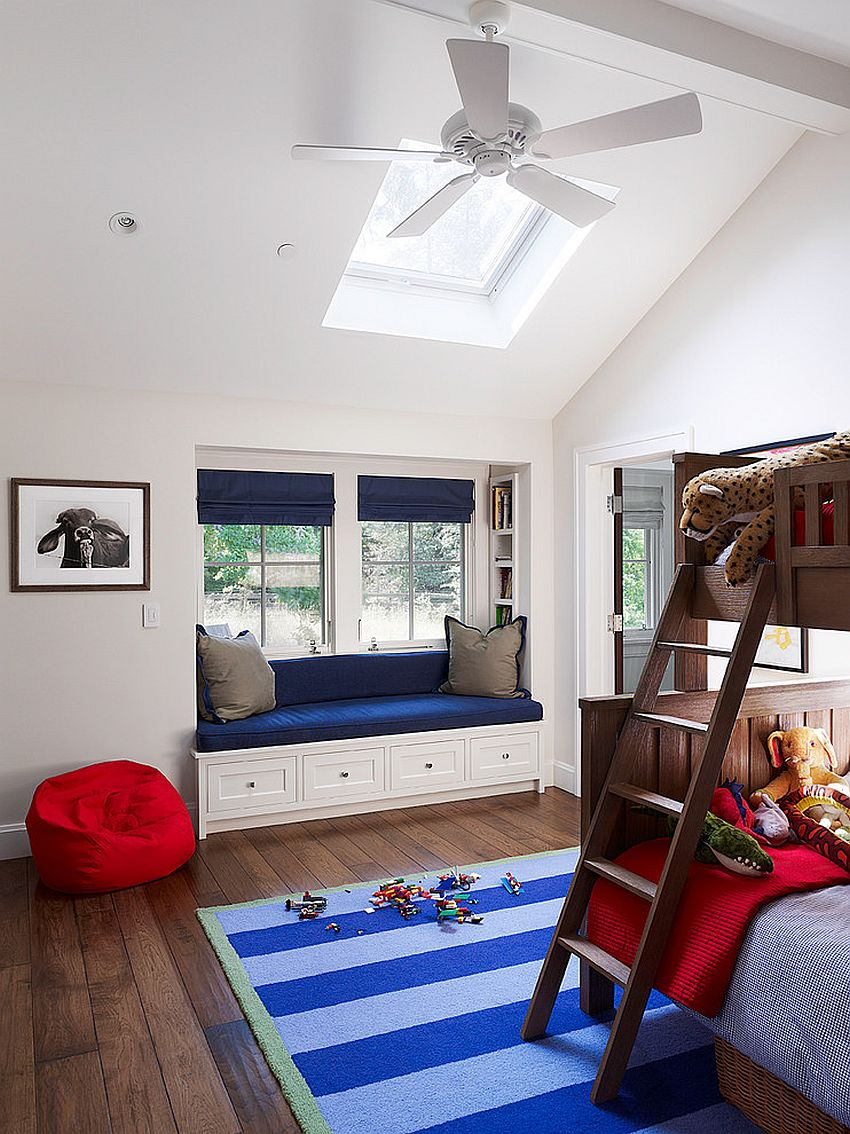 Kids' bedroom with bunk bed, a lovely window seat and skylight