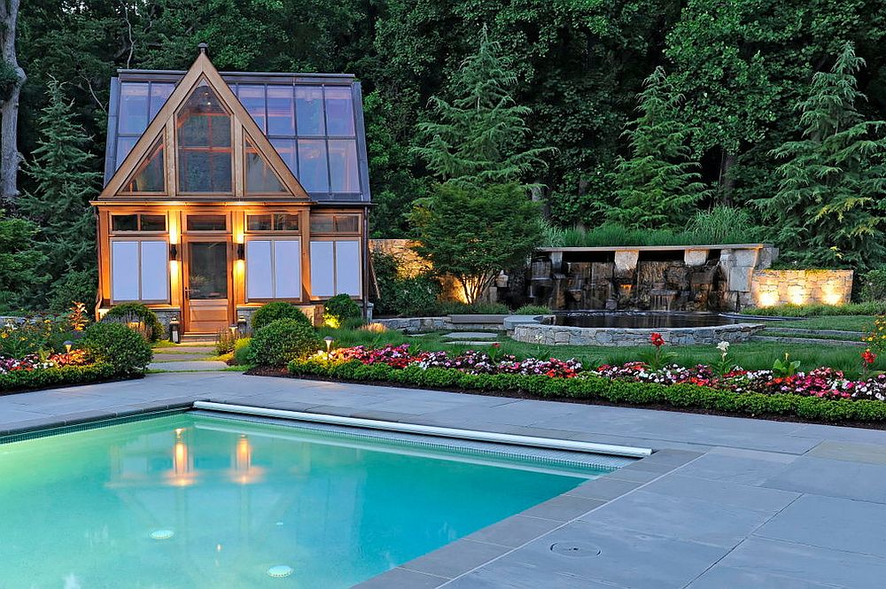 Style of the pool house perfectly complements that of the landscape around it [Design: SURROUNDS Landscape Architecture + Construction / Photography: Bob Narod]