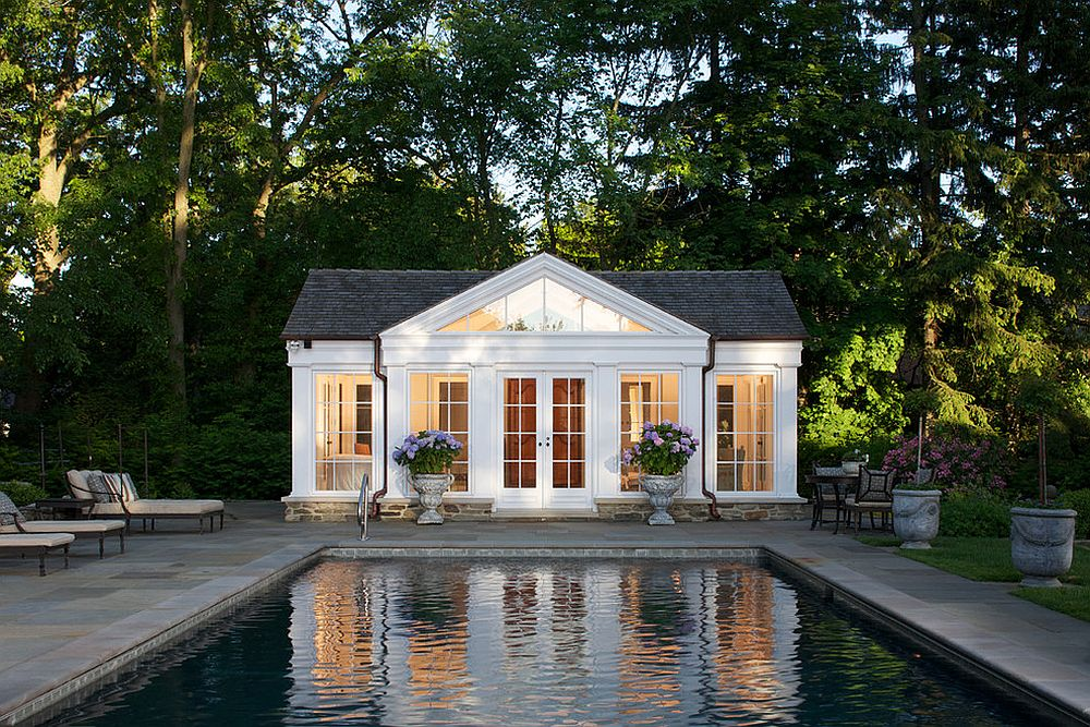 Traditional pool house in white with gray shingled roof [Design: Northworks Architects and Planners]